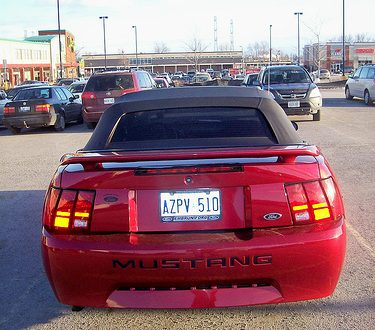 Another red Ford Mustang in a parking lot